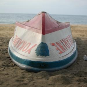 "Boat ""Yokarimbe"" upside-down on a beach on the Caribbean coast of Costa Rica"