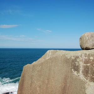 Random big round boulder perched precariously on an outcrop by the sea in Florianopolis, Brazil