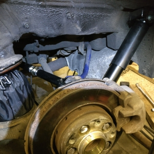 Rear near-side shock and spring fitted with protective gaitor over the spring.